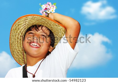 Happy laughing boy over blue sky - stock photo