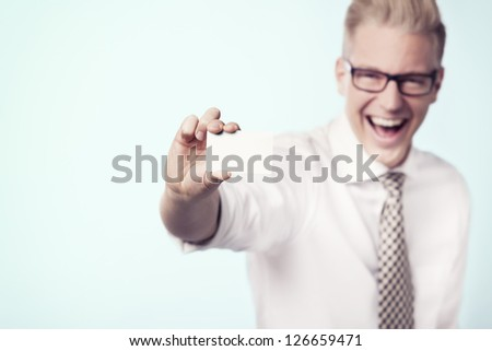 Happy laughing businessman presenting white blank business card with space for text, isolated. - stock photo