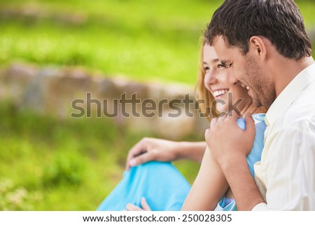 Happy Laughing Caucasian Couple Having Fun Outdoors and Embracing. Horizontal Image - stock photo