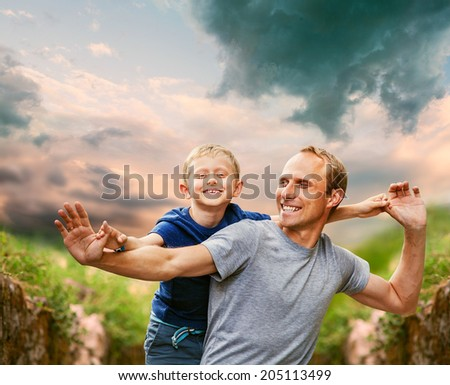 Happy laughing father with son - stock photo