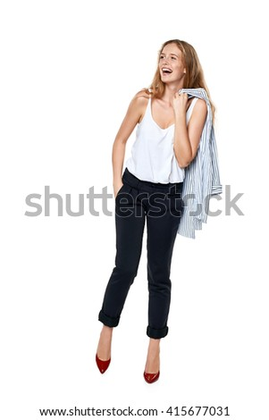 Happy laughing female in full length looking to the side at blank copy space, over white background - stock photo