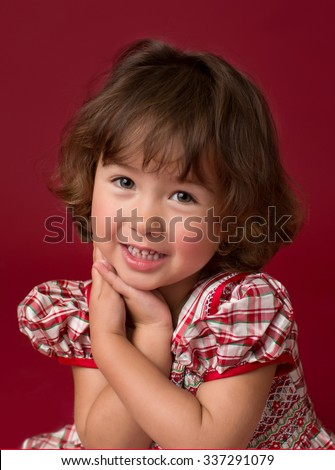 Happy, laughing girl in a Christmas dress, holiday outfit, fashion and xmas concept - stock photo