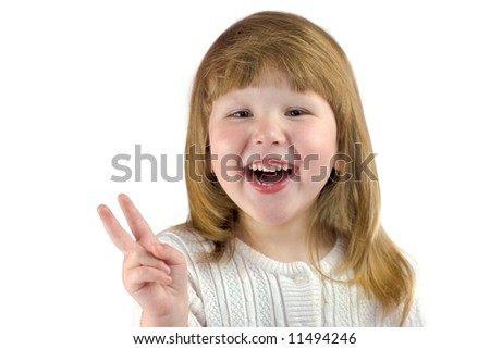 Happy laughing girl making Victory sign isolated on white - stock photo