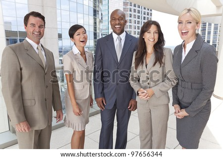 Happy laughing interracial group of business men & women, businessmen and businesswomen team - stock photo