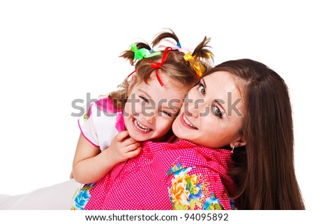 Happy laughing kid embracing beautiful mother, over white - stock photo