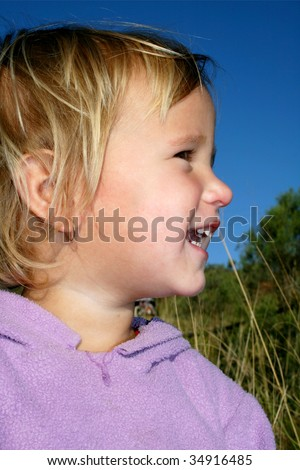Happy laughing little blond girl - stock photo