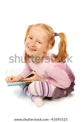 Happy laughing little girl with book isolated on white