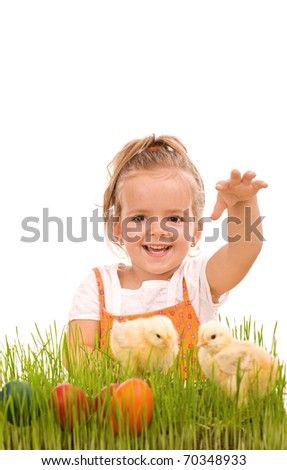 Happy laughing little girl with spring chicks and easter eggs in the grass - isolated - stock photo