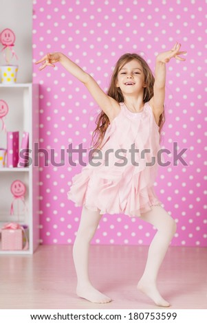 happy laughing little long hair girl dancing - stock photo