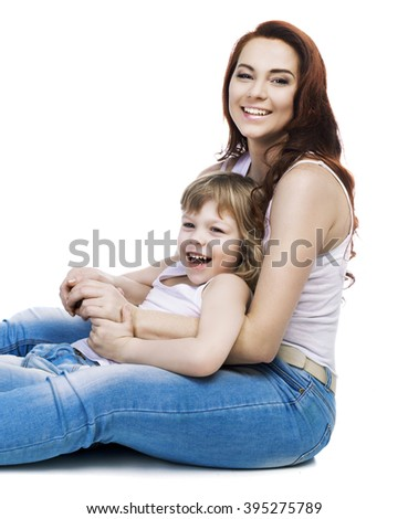 happy laughing mother and her son sitting on the floor, isolated against white studio background - stock photo