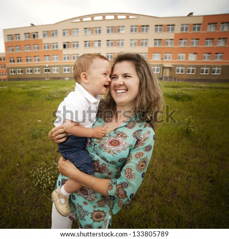 happy laughing mother with son - stock photo