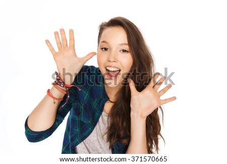 happy laughing pretty teenage girl showing hands