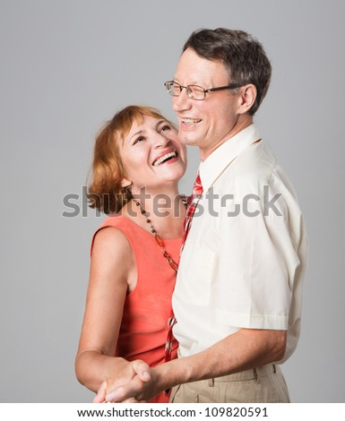Happy laughing senior couple having fun together - stock photo