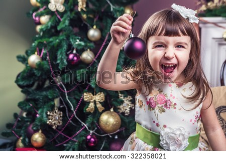 Happy laughing small girl with Christmas decorations. Have a great time holidays! Enjoy every moment. Merry Christmas and happy New Year! A series of photos - stock photo