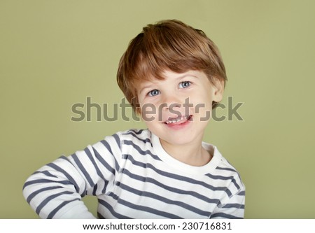 Happy, laughing, smiling child, looking straight at viewer - stock photo