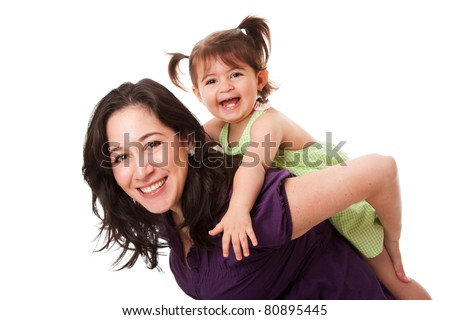 Happy laughing toddler girl playing with mom doing a fun piggyback ride, isolated. - stock photo