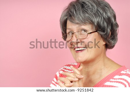 Happy, laughing woman enjoying her retirement - stock photo