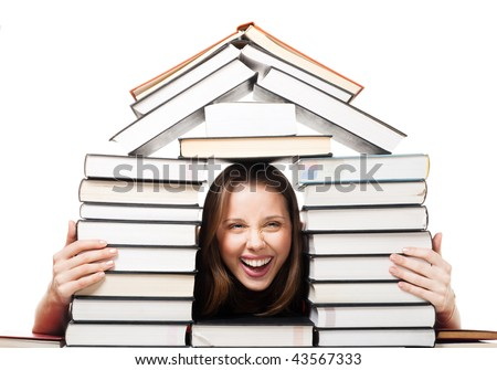 Happy laughing woman in house made of pile of books