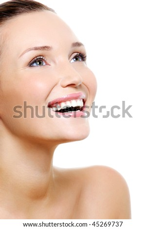 Happy laughing woman portrait with a white healthy teeth - isolated on white - stock photo