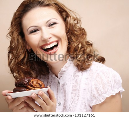 happy laughing woman with cake - stock photo