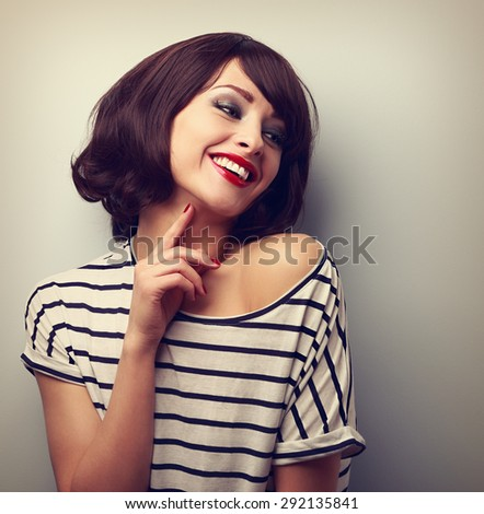 Happy laughing young short hairstyle woman in fashion blouse touching neck. Vintage closeup portrait - stock photo