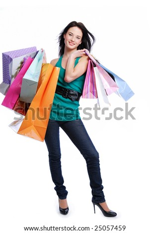 Happy laughing young woman with color bags - white background - stock photo