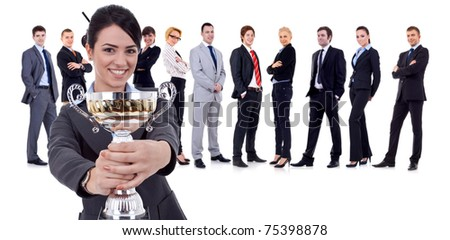 Happy leader holding a cup with her team behing - stock photo