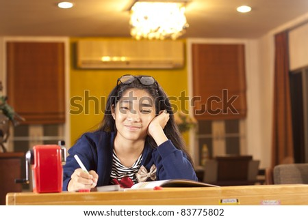 happy learn, a girl learning home school smiling. - stock photo