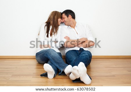 Happy lifestyle couple enjoying new real home after move - stock photo