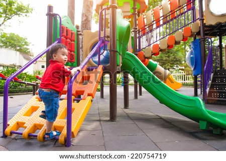 Happy little asian boy, elementary aged child in the garden playground in the park  - stock photo
