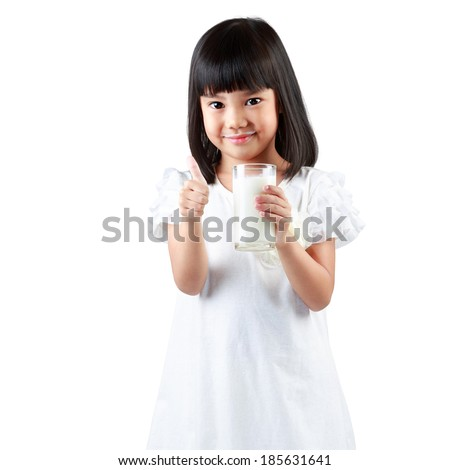 Happy little asian girl holding a cup of milk, Isolated over white - stock photo