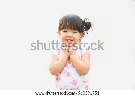 Happy Little asian girl in chinese traditional dress smiling.