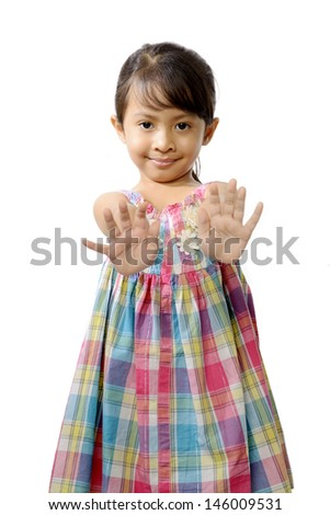 Happy little asian girl isolated over white background