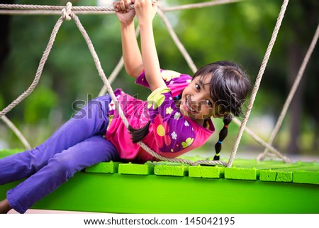 Happy little asian girl on the playground, Outdoor portrait - stock photo