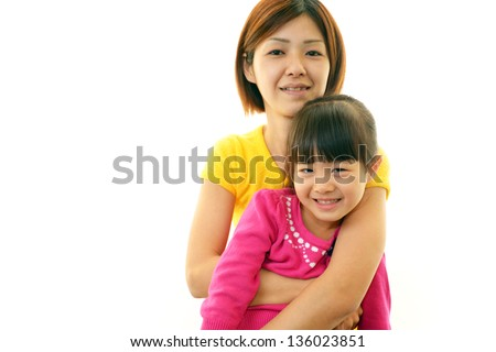 Happy little Asian girl with mother