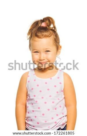 Happy little Asian 4 years old girl with amazing smile standing isolated on white