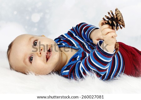 Happy little baby boy laughing - stock photo