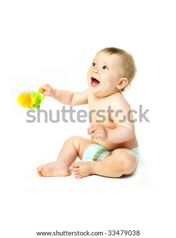 happy little baby boy with a toy in his hands - stock photo