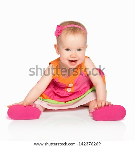 happy little baby girl in bright multicolored festive dress isolated on a white background - stock photo