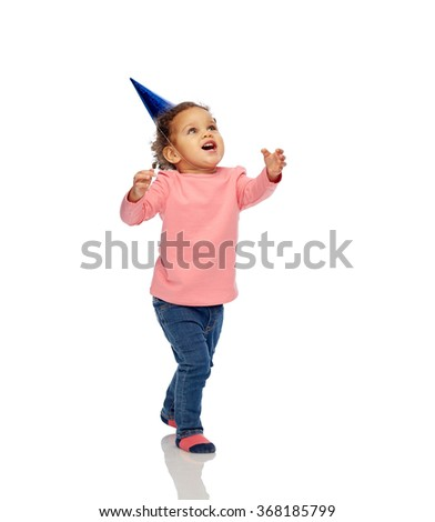happy little baby girl with birthday party hat - stock photo