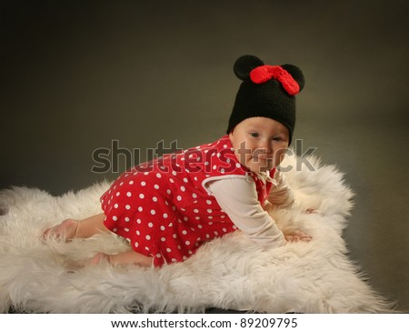 happy little baby on grey background - stock photo