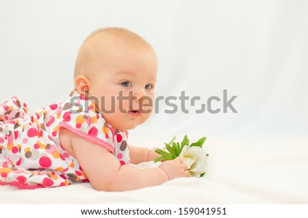 happy little baby with flower - stock photo