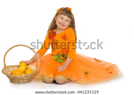 Happy little blond girl, in a bright orange dress, with a basket in which lay a ripe pumpkin - Isolated on white background - stock photo