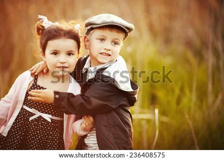 happy little boy and girl hug - stock photo