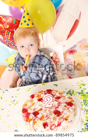 happy little boy celebrates birthday - stock photo