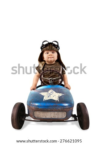 Happy little boy driving big vintage old toy car and having fun, isolated on white - stock photo