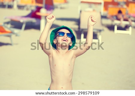 Happy little boy enjoying the summer holiday outdoor, vintage style - stock photo
