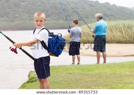 happy little boy fishing with family - stock photo