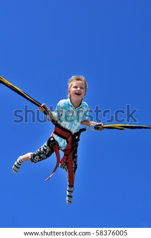 happy little boy flying over the blue sky - stock photo