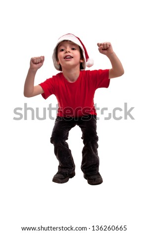 Happy little boy in hat of Santa Claus enjoying that Christmas is coming on white background - stock photo